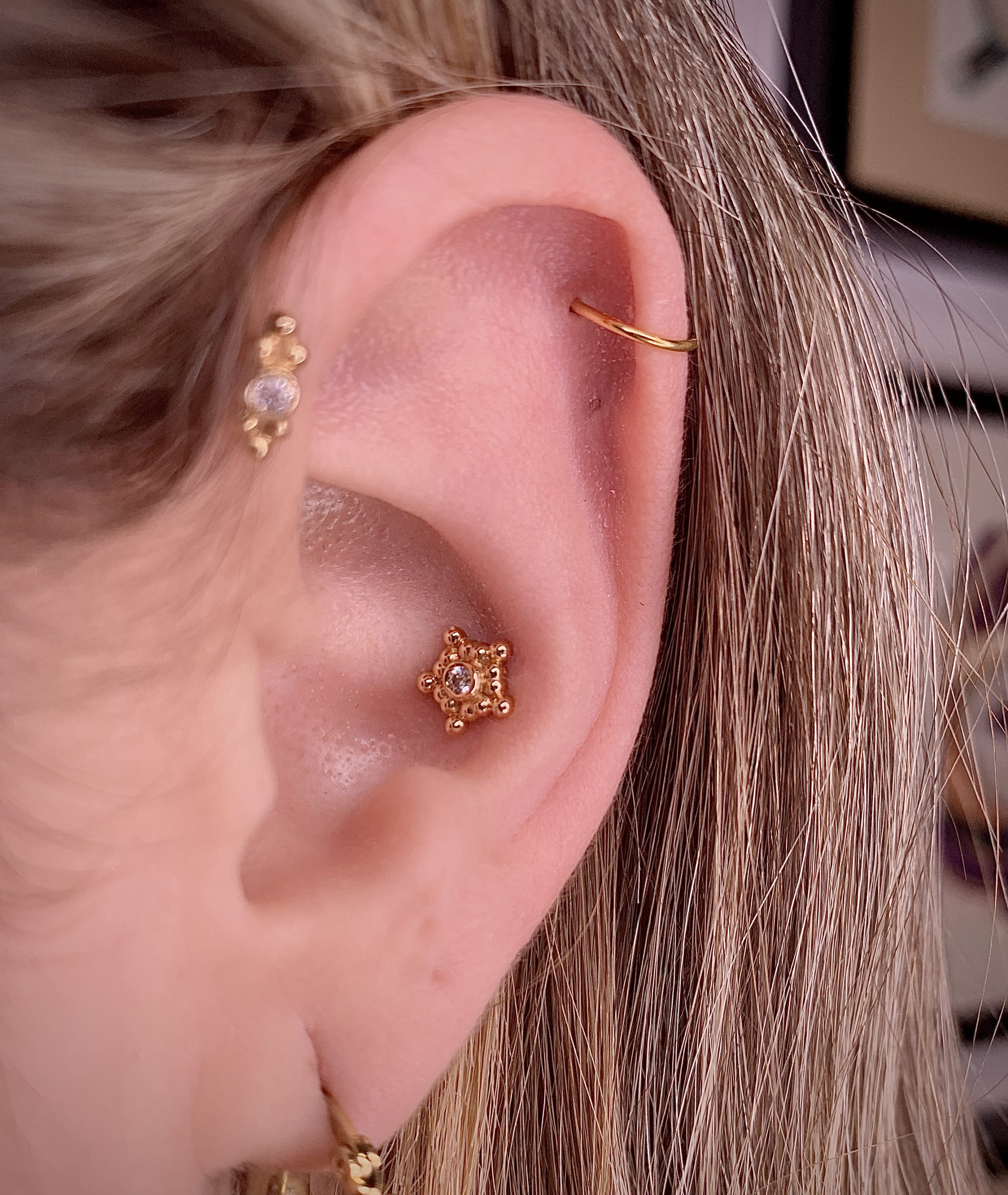 Ear Piercing upgrade. Jewelry tops are from anatometal inc. 18k yellow gold Sabrinas. Piercing Barcelona