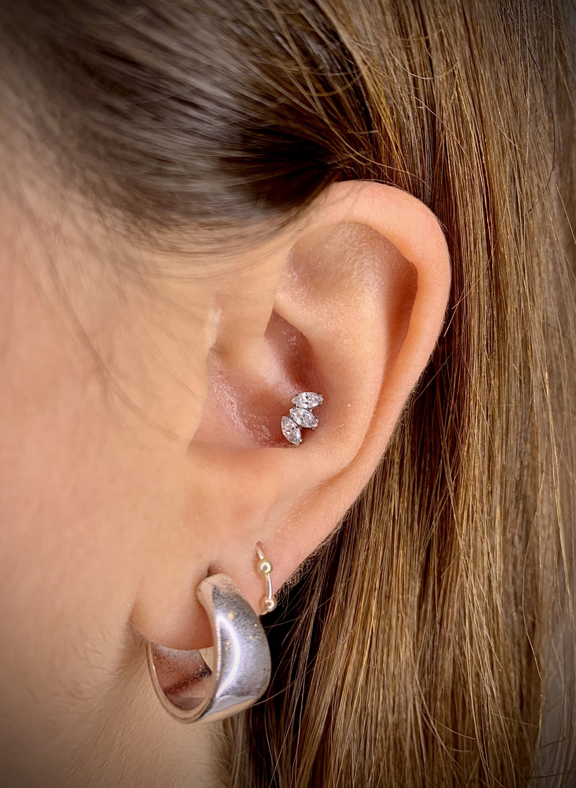 Ear piercing, Conch piercing, Titanium Marquise Fan with Swarovski zirconia from Industrial Strenght. Piercing Barcelona